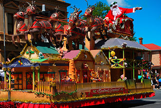 Christmas in Australia and New Zealand - A float in the 2008 Norwood Christmas pageant depicting Santa Claus' sleigh on top of Australian-style historic buildings