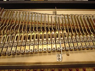 Rhodes piano - The Rhodes piano generates its sound by hammers hitting a length of wire known as a tine.