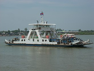 Transport in Cambodia - A ferry taking vehicles and passengers across the Mekong to Neak Leung town.
