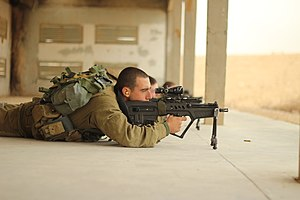 IWI Tavor - A Nahal solder conducts firing drill with a CTAR-21.