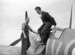 "Flight Sergeant George ""Grumpy"" Unwin of No. 19 Squadron RAF climbs out of his Supermarine Spitfire Mk I at Fowlmere, near Duxford in Cambridgeshire after a sortie, September 1940. CH1355.jpg"