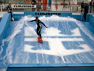 Flowriding boardsport in which athletes ride on boards atop stationary artificial waves over surfaces engineered to replicate the shape of ocean waves