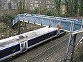 Footbridge and passing train - geograph.org.uk - 1506651.jpg