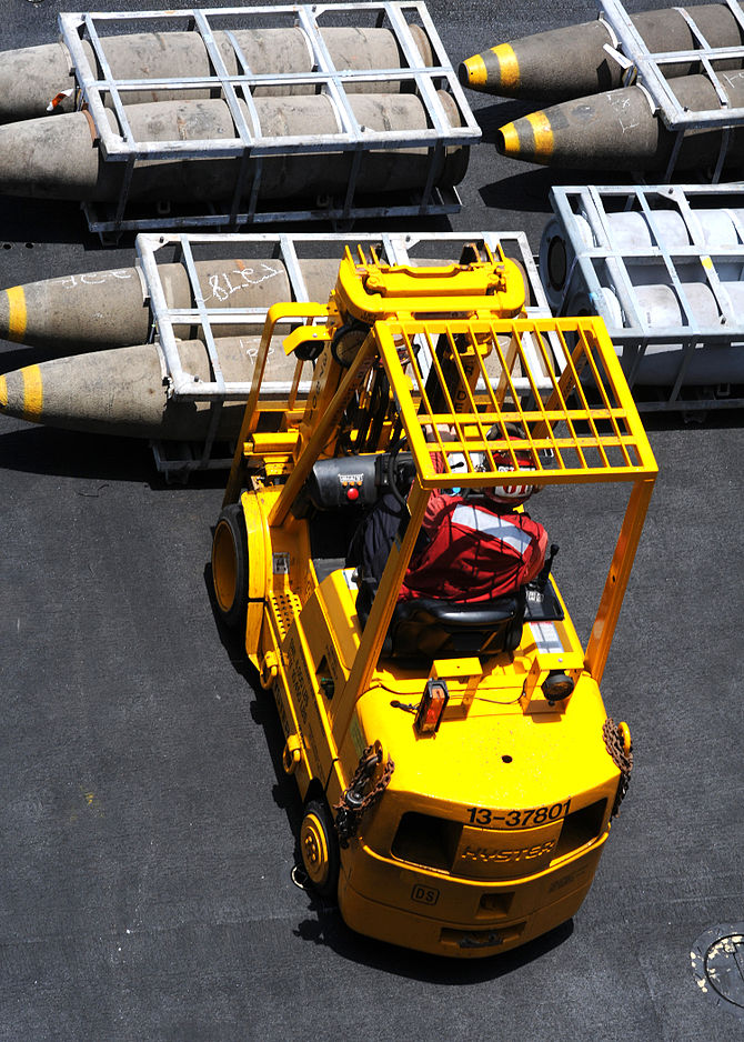 English: A fork-lift operator from aircraft el...