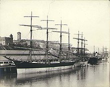 Four-masted bark PLACILLA along with other sailing vessels and steamships at the Northwestern Inprovement Co dock, Tacoma (HESTER 126).jpeg