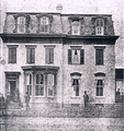 Frederick Douglass in front of his A Street NE home 1876.png
