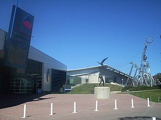 Australian Sports Commission - ASC is located at the AIS site in Canberra. Sports Visitor Centre on the left, AIS arena at the back right