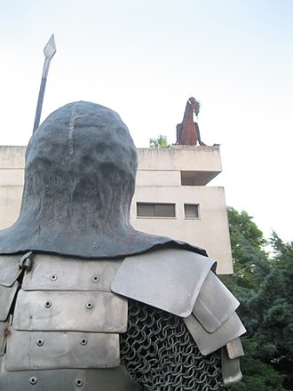 Kfar HaNassi - Statues of a knight and a dragon at the dining hall building