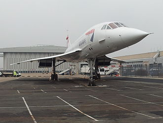 BA Concorde G-BOAB at London Heathrow Airport. This aircraft flew for 22,296 hours between its first flight in 1976 and its final flight in 2000, and has remained there ever since. G-BOAB in new home (8472694454).jpg