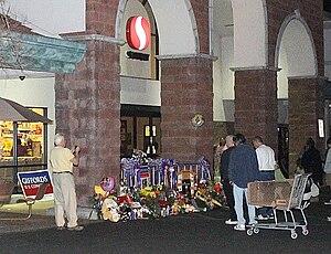 English: Makeshift memorial at massacre site. ...