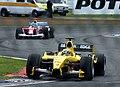Giorgio Pantano - Jordan EJ14 heads Cristiano da Matta - Toyota TF104 during practice for the 2004 British Grand Prix (50830957773).jpg