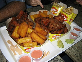 Frying - Fried polenta, French fries, and fried chicken at a Brazilian eatery