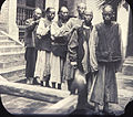 Group of men walking in a line outside the hospital, Changde, Hunan, China, ca.1900-1919 (IMP-YDS-RG008-358-0008-0075).jpg