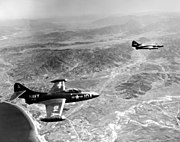 Grumman F9F-2B Panthers of VF-721 in flight over Korea on 15 July 1951 (80-G-431906)