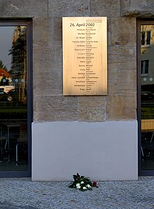 A memorial plaque to the shooting
