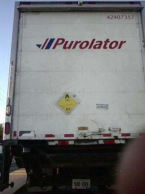 Purolator Inc. - Purolator truck showing the HAZMAT Class 5 Oxidizing Agents and Organic Peroxides placard on the rear door.