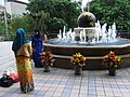 HK Causeway Bay HKCL Globe fountain n Indonesian clothing Headscarf Aug-2012.JPG