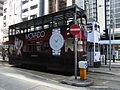 HK Sheung Wan Tram Station Des Voeux Road Central tram body Movado angel face waiting May-2012.JPG
