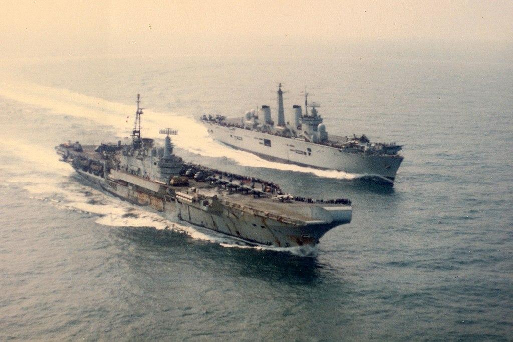 HMS Illustrious steams past HMS Hermes, 20-07-1982 (35286420990).jpg