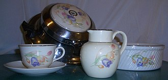 The Hall China Company - Hall China breakfast set including waffle iron, batter bowl, syrup jug, coffee cup with saucer (waffle iron manufactured by ElectraHot of Minneapolis, Minnesota with Hall China insert)