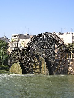 Noria machine activated by water power and used for lifting water into a small aqueduct