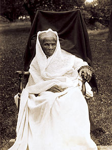 Photo of Tubman seated and dressed in white