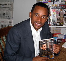 Harper signing copies of his book letters to a young brother 2007