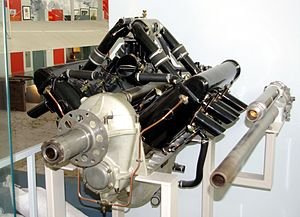 "René Fonck - A geared-output shaft HS.8C engine for a SPAD S.XII, showing the elevated intake manifold to clear the 37mm cannon mounted in the ""vee"" between the cylinder banks."