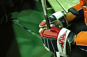 Glove (ice hockey) - A player's gloved hands.