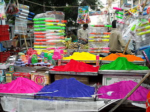 Holi Powder and Water Guns (Pitchkaris) on Sale Rajasthan India 2009.jpg
