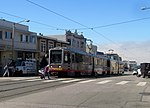 Inbound train at Taraval and 26th Avenue, September 2017.JPG