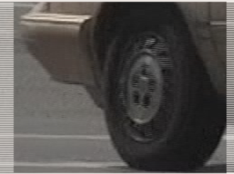 Interlaced video - Picture of a moving car tire, interlace combing reduced by realigning the even and odd field on the X axis. The other field has been moved 16 pixels right, reducing the combing on the bumper and the tire outline, but the hub cap that has turned between the fields has notable combing.