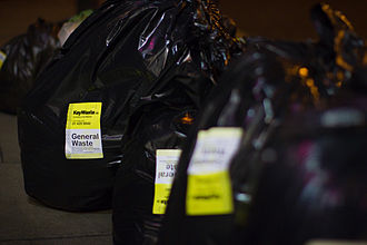 Waste collection - Waste on a sidewalk for collection, bagged and stickered - in Dublin, Ireland