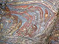 Jaspilite banded iron formation (Soudan Iron-Formation, Neoarchean, ~2.69 Ga; Stuntz Bay Road outcrop, Soudan Underground State Park, Soudan, Minnesota, USA) 27 (19039636889).jpg