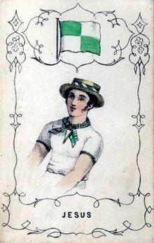 Мужчина в бело-зеленом шейном платке и соломенной канотье под бело-зеленым флагом.