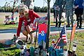 Jill Biden lays a rose at the base of a tree along the Warriors Walk on Fort Stewart, 2011.jpg