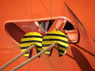 Animal repellent - Rat guards: steel or aluminum discs attached to the mooring line to prevent rats from boarding a ship