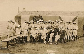 Navy, Army and Air Force Institutes - European personnel outside Kamaran Island's NAAFI canteen in 1927