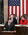 King Abdullah of Jordan addresses Congress March 7, 2007, behind are VP Dick Cheney (l) and House Speaker Nancy Pelosi (r).jpg