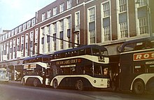 "Trolley buses on Hull's King Edward Street in 1963, two years after Larkin finished ""Here"""