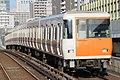 Kintetsu 7108 at Kujo Station.jpg