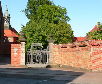 Walsrode Abbey - Main gate and convent wall. Left: the chapel