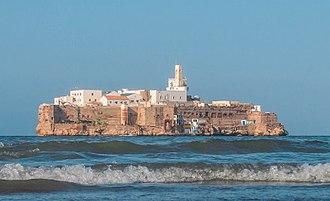 Peñón - Peñón de Alhucemas, viewed from the Moroccan coast.