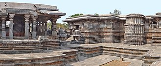 Hoysaleswara Temple - A Nandi shrine (left) facing the sanctum of the main temple