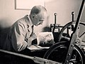 Leonard Beaumont printing his etching 'Fribourg', 1928.jpg