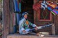 Lijiang Yunnan China-Woman-with-weaving-loom-01.jpg