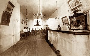Bat Masterson - Photograph of the interior of the Long Branch Saloon in Dodge City, Kansas, taken between 1870 and 1885.
