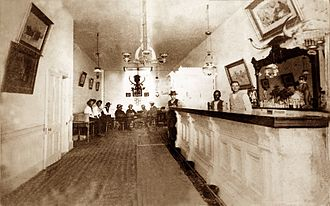 Bat Masterson - Photograph of the interior of the Long Branch Saloon in Dodge City, Kansas, taken between 1870 and 1885