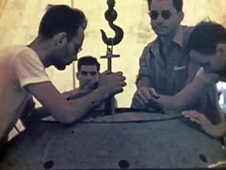 Demon core - The two physicists Harry Daghlian (center left) and Louis Slotin (center right) during the Trinity Test