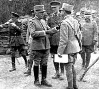 Luigi Cadorna, (the man to the left of two officers to whom he is speaking) while visiting British batteries during World War I.